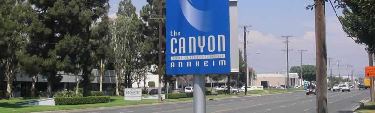 Sign for the Canyon Anaheim next to the road