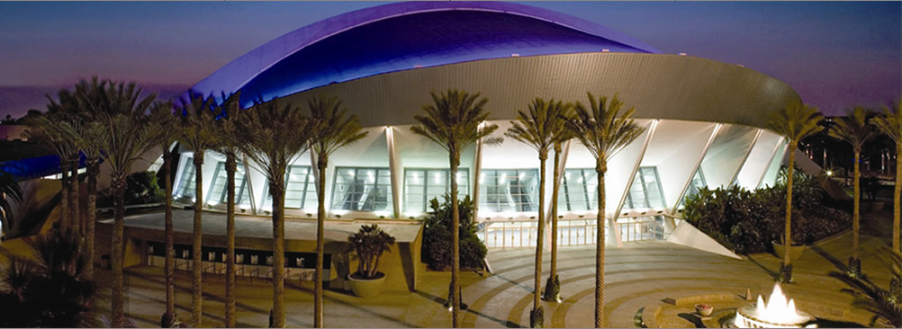Convention Center front entrance with palm tress around the out side of the building